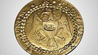 золотая монетка 1 $