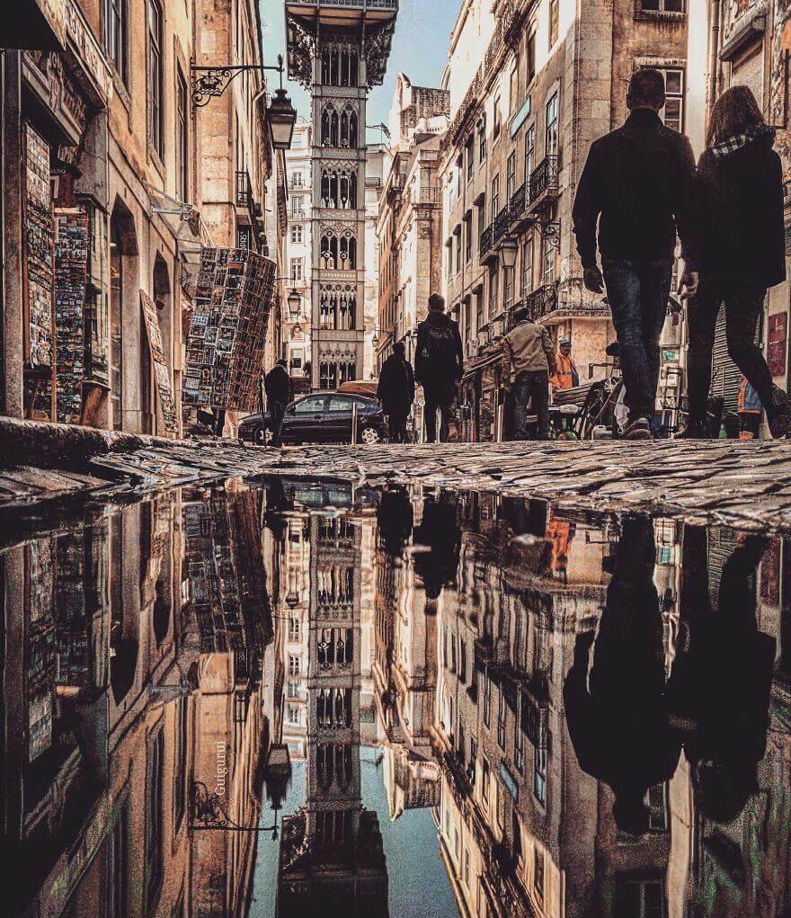города в отражении лужи, Лиссабон, Португалия